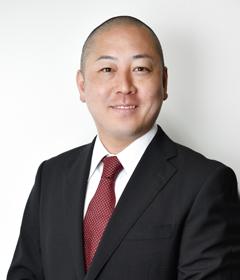 写真:取締役 岡本 邦美